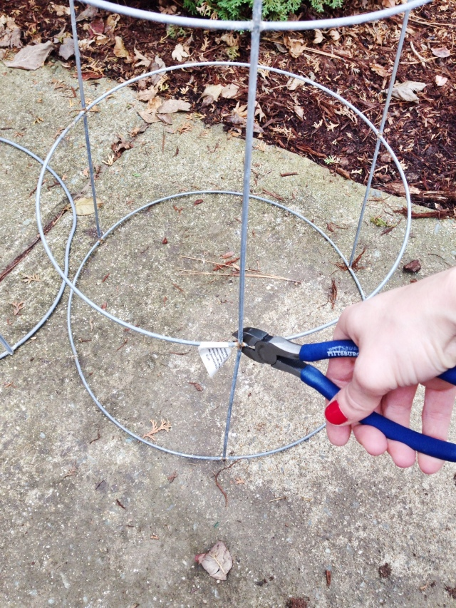Step One: Cut the lowest level off the tomato cage for your DIY Christmas Tree