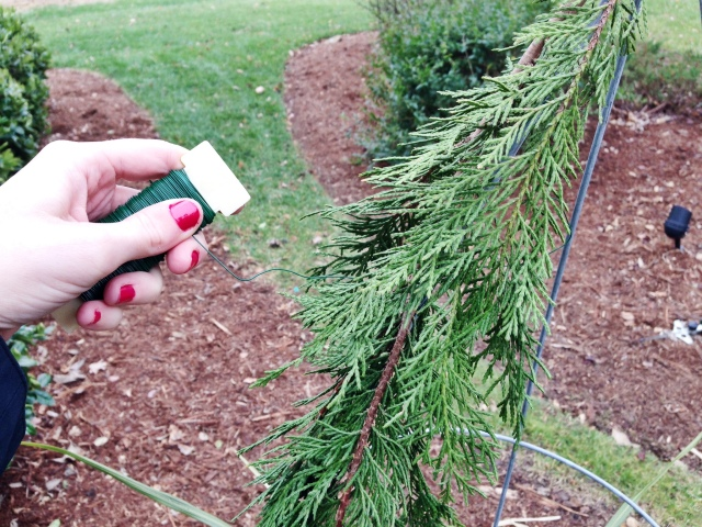 Wrap floral wire around your pine branches to create a base for your DIY Christmas Tree